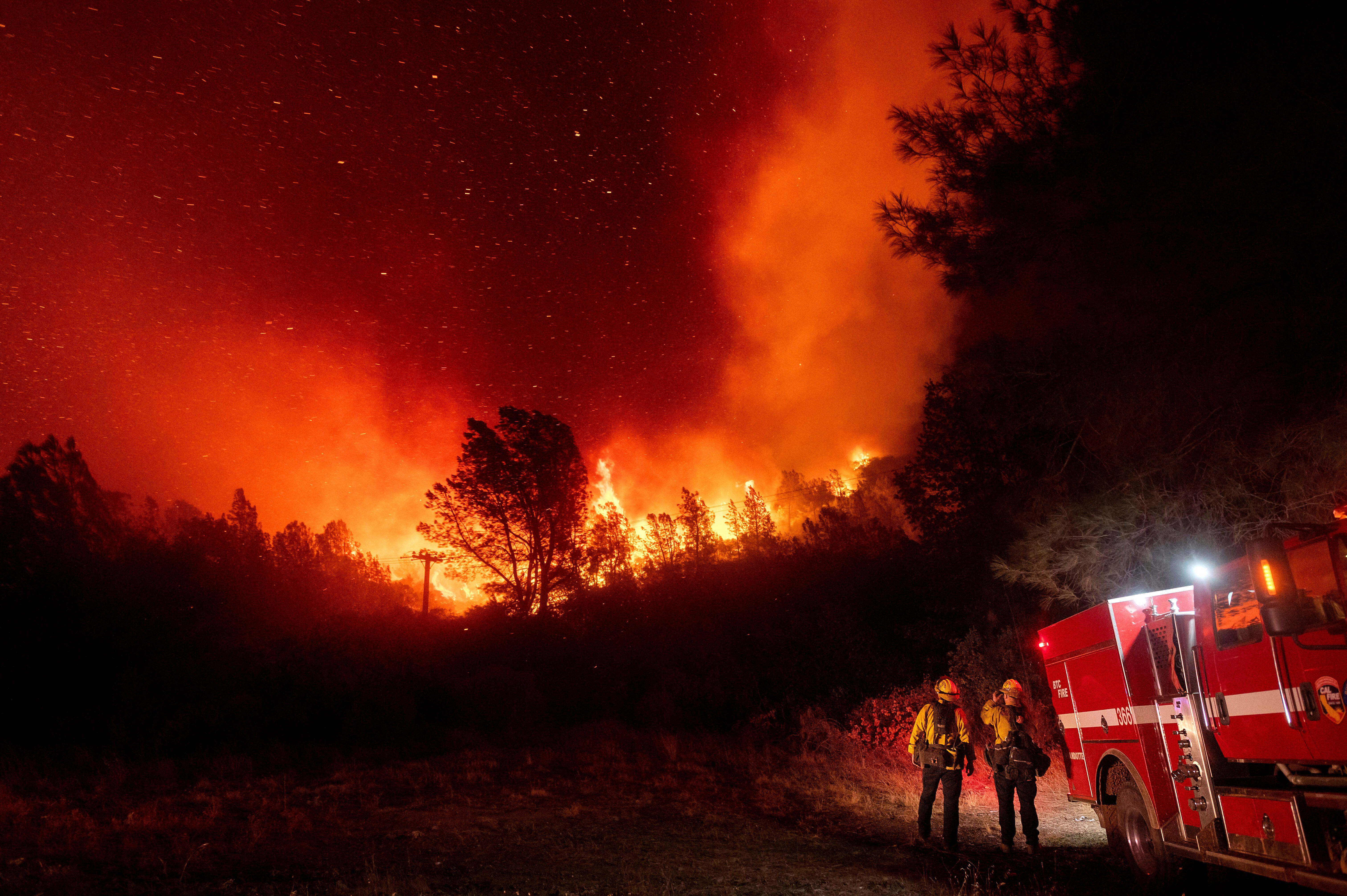 Firefighters watch the Bear Fire approach in Oroville, California on Wednesday. The blaze, part of the lightning-sparked Nort