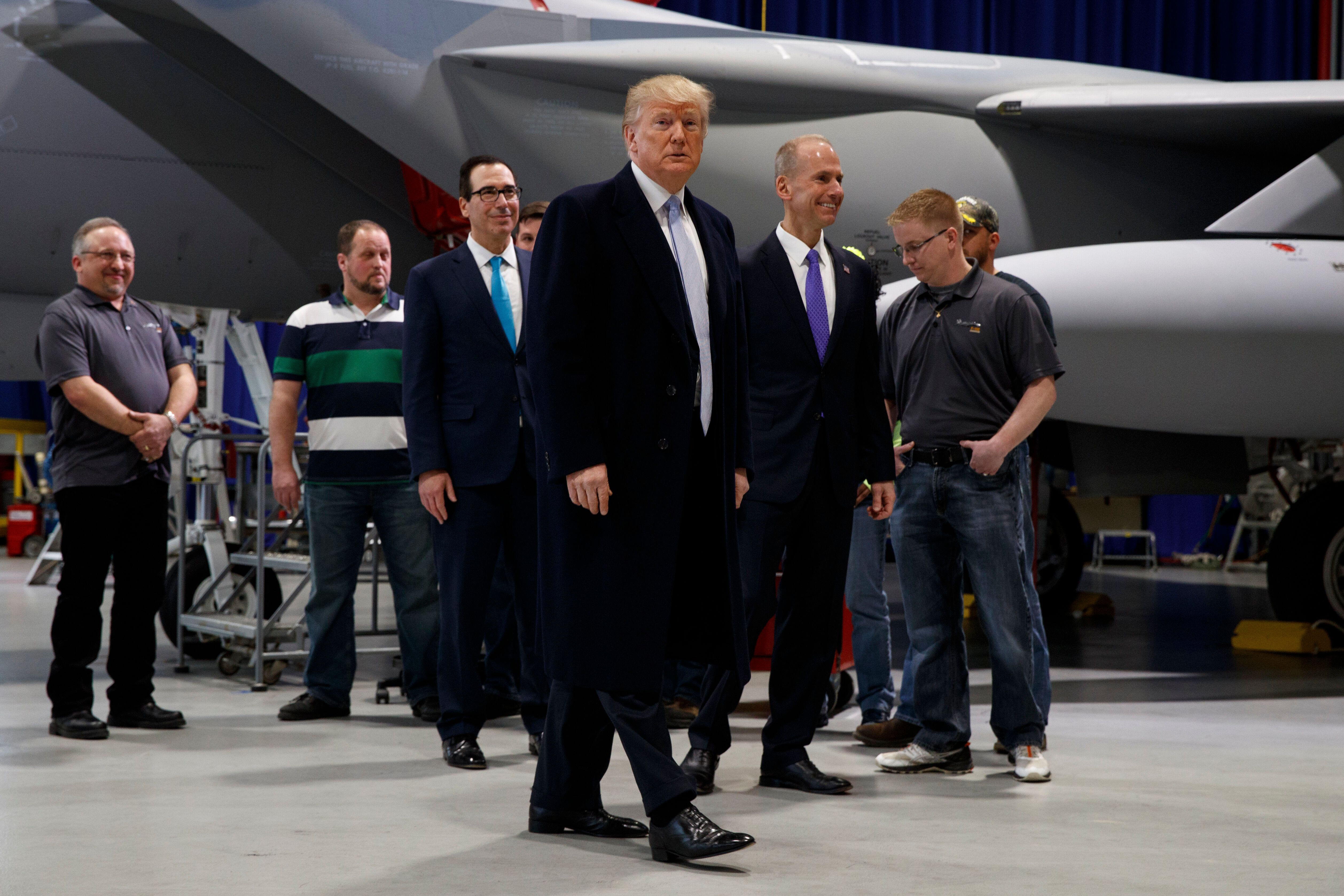 President Donald Trump participates in a tour of fighter aircraft at the Boeing Company on March 14, 2018, in St. Louis.