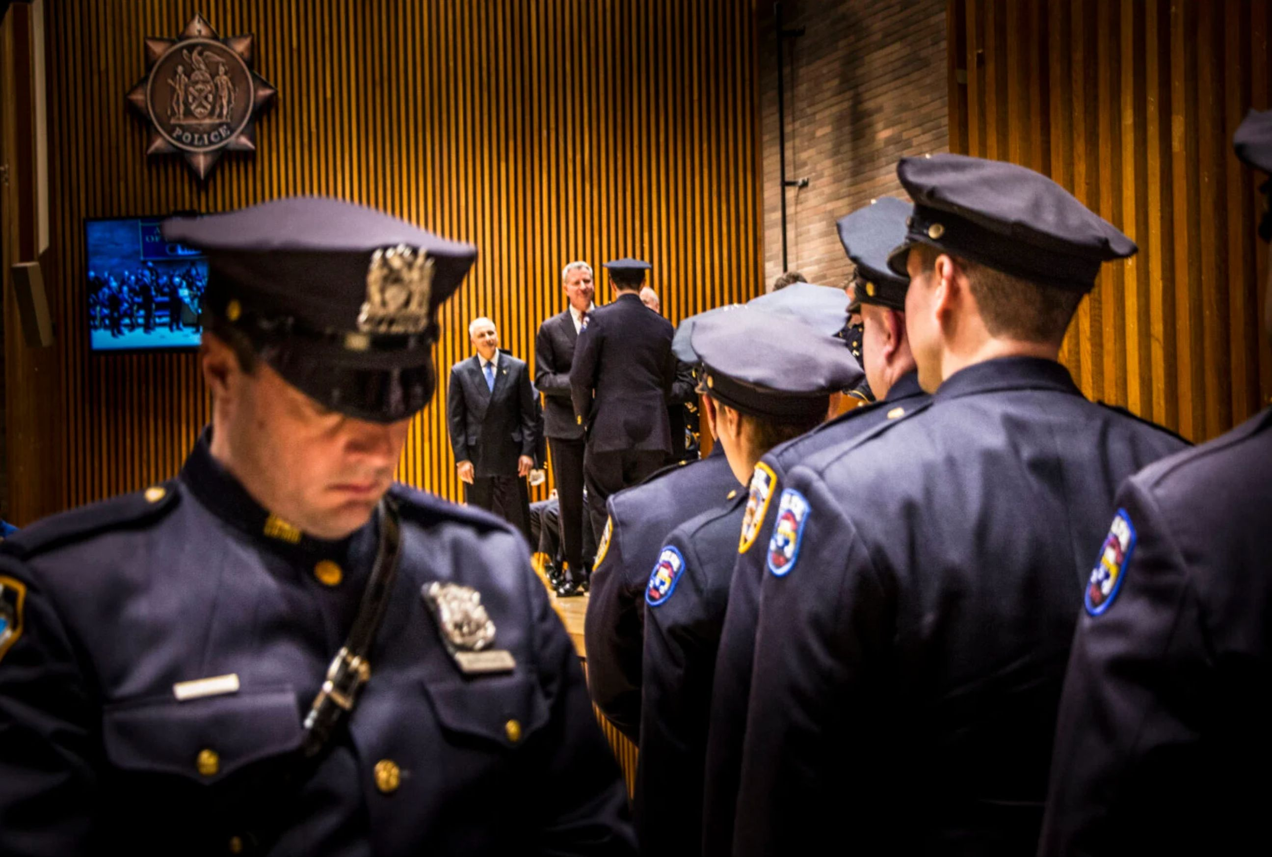 Mayor Bill de Blasio and Bratton congratulate officers at a promotion ceremony in 2014. (Mark Peterson/Redux)