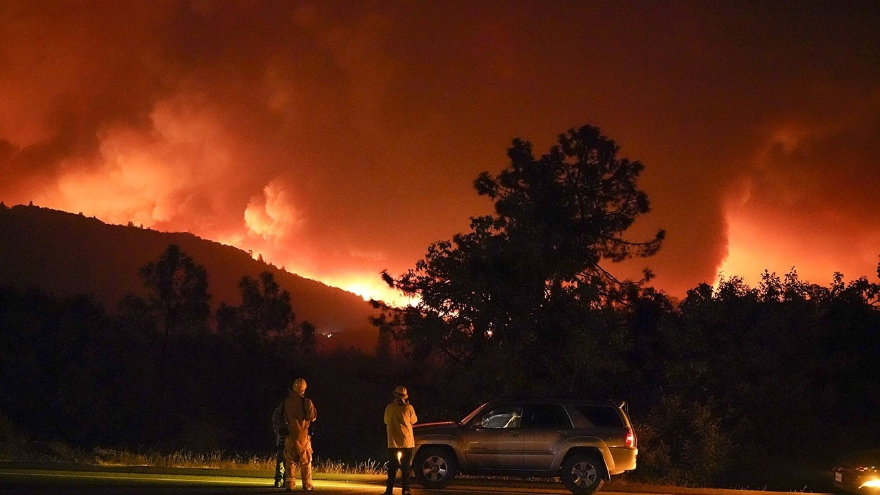 Wildfires raging across the West Coast kill at least 7, including 2 children