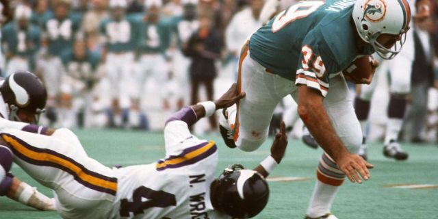 Larry Csonka (39) of the Miami Dolphins runs through the tackle of Nate Wright (43) of the Minnesota Vikings during Super Bowl VIII at Rice Stadium, Jan. 13, 1974, in Houston, Texas. The Dolphins won the Super Bowl 24-7. (Focus on Sport/Getty Images)