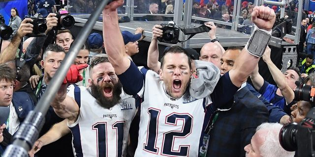 Julian Edelman (11) of the New England Patriots and teammate Tom Brady (12) celebrate at the end of Super Bowl LIII at Mercedes-Benz Stadium on Feb. 3, 2019, in Atlanta, Ga. The New England Patriots defeated the Los Angeles Rams 13-3. (Harry How/Getty Images)