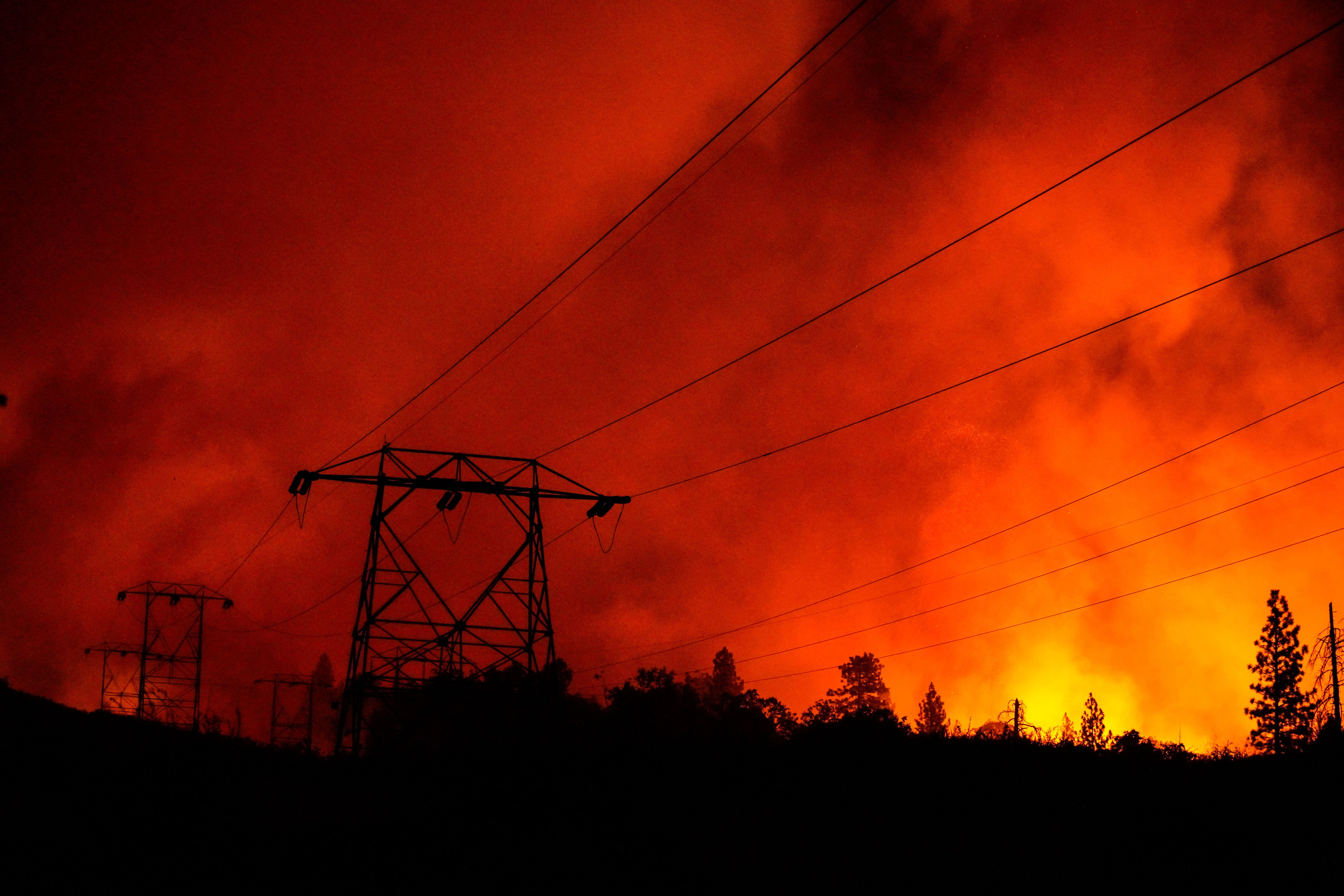 The Creek Fire creeps up on the Shaver Springs community on Sept. 8, 2020, in Auberry, California.
