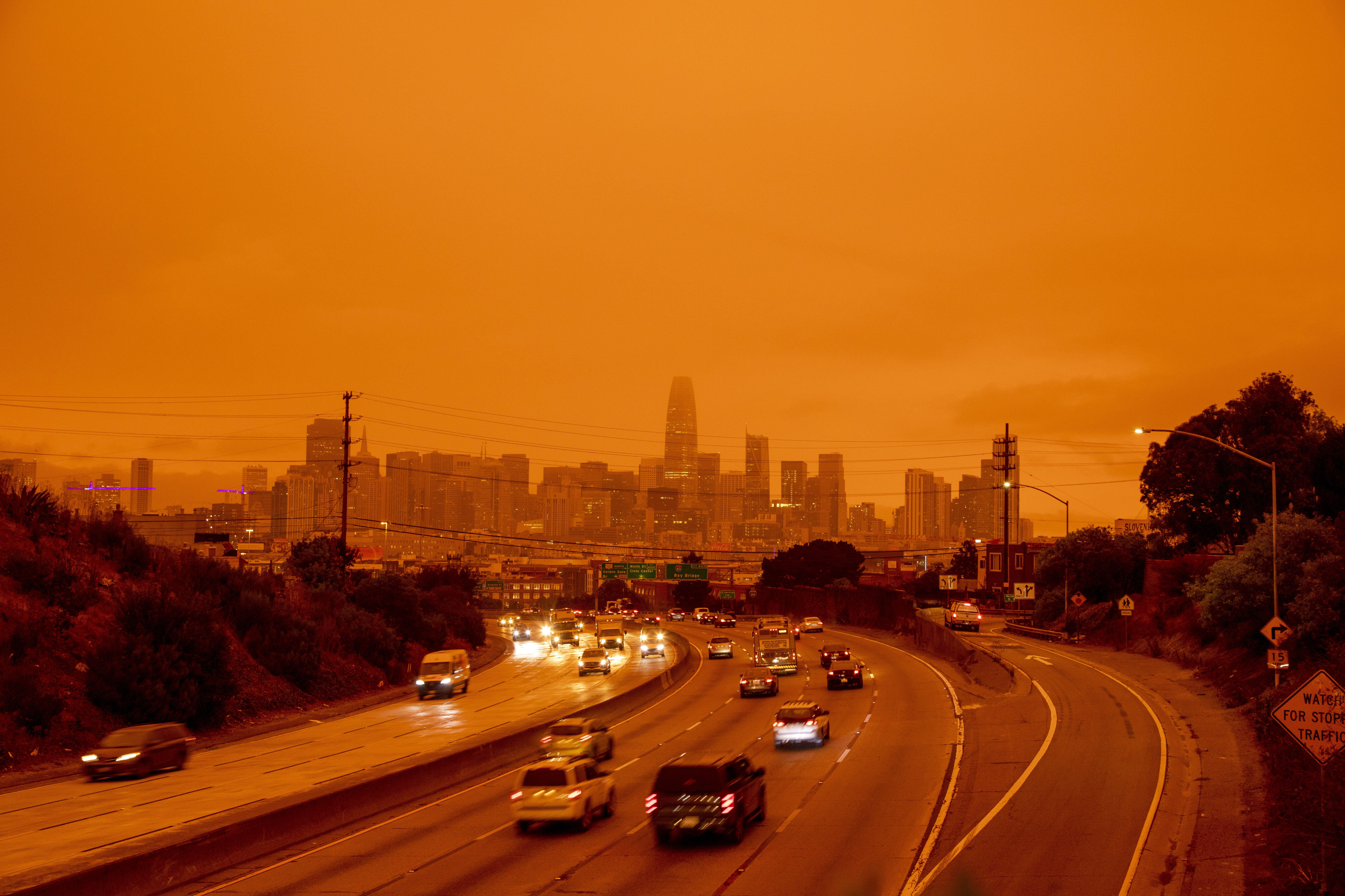 A layer of smoke generated by over two dozen wildfires burning in California created and eerie orange glow over much of the S