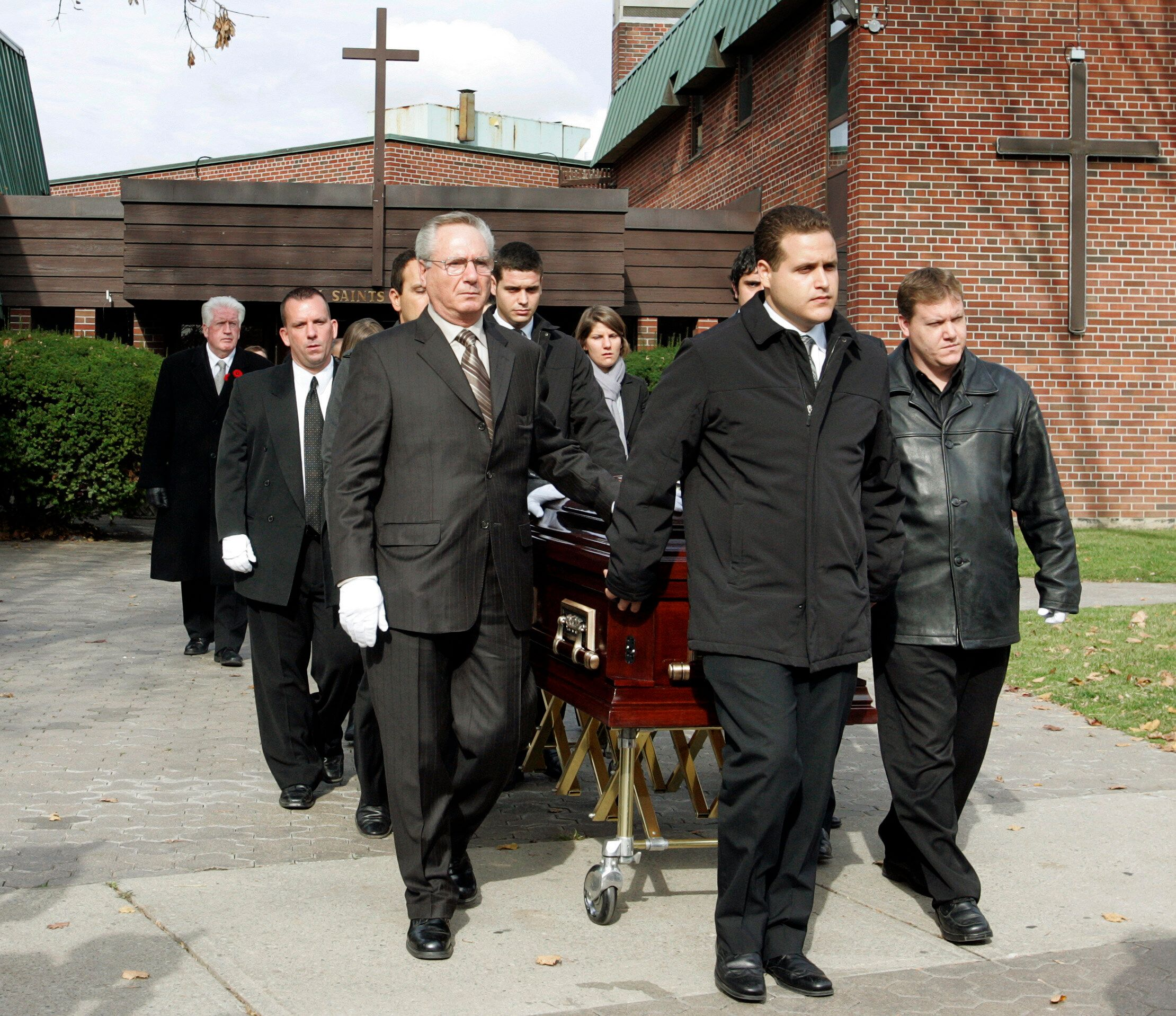 Pallbearers walk with the casket after funeral services for 13-year-old Evan Frustaglio in Toronto on Nov. 2, 2009. Frustagli