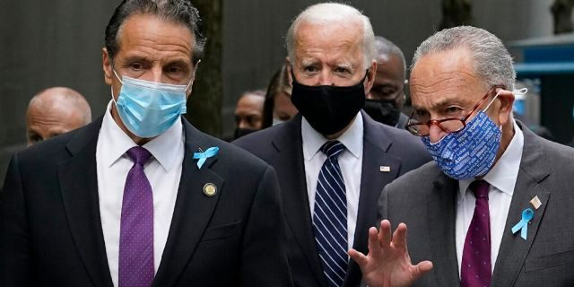 Democratic presidential candidate and former Vice President Joe Biden, center, walks with New York Gov. Andrew Cuomo, left, and Senate Minority Leader Sen. Chuck Schumer of N.Y., after arriving at the National September 11 Memorial in New York, Friday, Sept. 11, 2020, for a ceremony marking the 19th anniversary of the Sept. 11 terrorist attacks. (AP Photo/Patrick Semansky)<br>