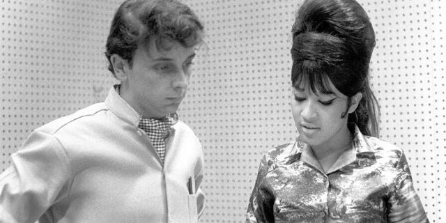 Ronnie Spector of the vocal trio the Ronettes with Phil Spector while recording in Los Angeles, California at Gold Star Studios in 1963.