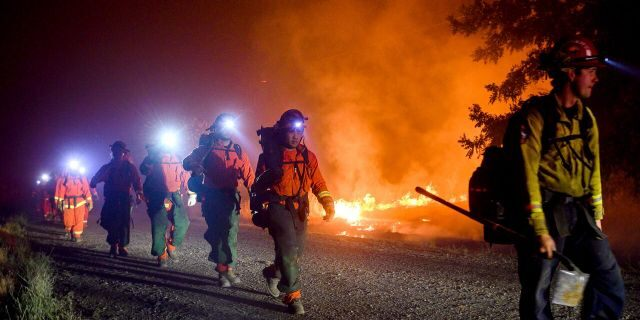 Inmate firefighters, left, battle the Quail Fire burning near Winters, Calif., on Sunday, June 7, 2020.