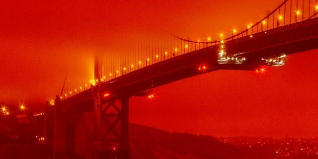In this photo provided by Frederic Larson, the Golden Gate Bridge is seen at 11 a.m. PT, Sept. 9, in San Francisco, amid a smoky, orange hue caused by the ongoing wildfires. (Frederic Larson via AP)