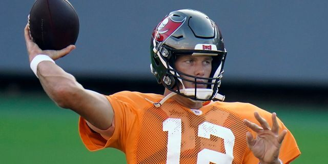 Tampa Bay Buccaneers quarterback Tom Brady (12) throws a pass during an NFL football training camp practice Aug. 28, in Tampa, Fla. (AP Photo/Chris O'Meara)