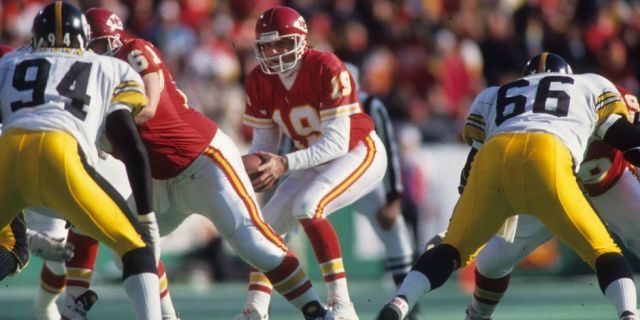 Quarterback Joe Montana #19 of the Kansas City Chiefs drops back to pass against the Pittsburgh Steelers in the 1993 AFC Wild Card Game at Arrowhead Stadium on January 8, 1994 in Kansas City, Missouri. The Chiefs defeated the Steelers 27-24 in overtime. (Photo by Joseph Patronite/Getty Images)