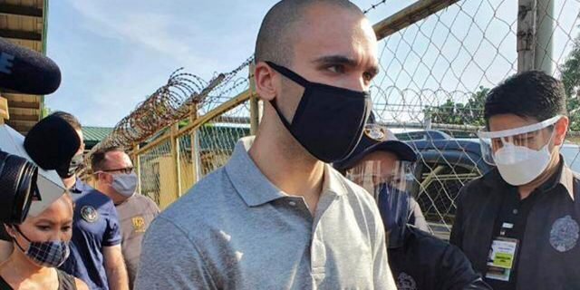 In this photo provided by the Philippines' Bureau of Immigration, U.S. Marine Lance Cpl. Joseph Scott Pemberton gets ready to leave Camp Aguinaldo on his way to the airport in Quezon city, Philippines, Sunday, Sept. 13, 2020. Pemberton, a U.S. Marine convicted of killing a Filipino transgender woman, was deported Sunday after a presidential pardon cut short his detention in a case that renewed outrage over a pact governing American military presence in the Philippines. (Bureau of Immigration via AP)