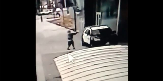 A screen grab from a security camera video released the Los Angeles County Sheriff's Department shows a gunman walking up to sheriff's deputies and opening fire without warning or provocation in Compton, Calif., on Saturday, Sept. 12, 2020. (Los Angeles County Sheriff's Department via AP)
