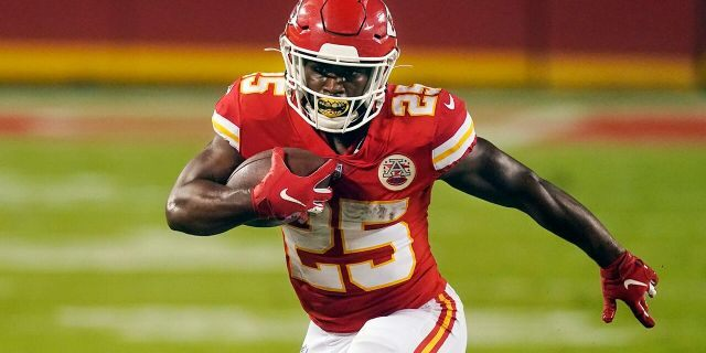 Kansas City Chiefs running back Clyde Edwards-Helaire carries the ball against the Houston Texans in the first half of an NFL football game Thursday, Sept. 10, 2020, in Kansas City, Mo. (AP Photo/Charlie Riedel)