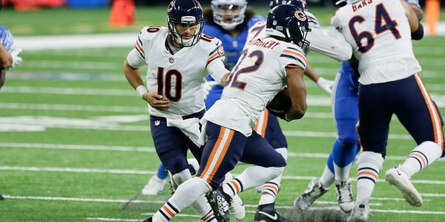 Chicago Bears quarterback Mitchell Trubisky (10) hands off to running back David Montgomery (32) in the second half of an NFL football game in Detroit, Sunday, Sept. 13, 2020. (AP Photo/Duane Burleson)