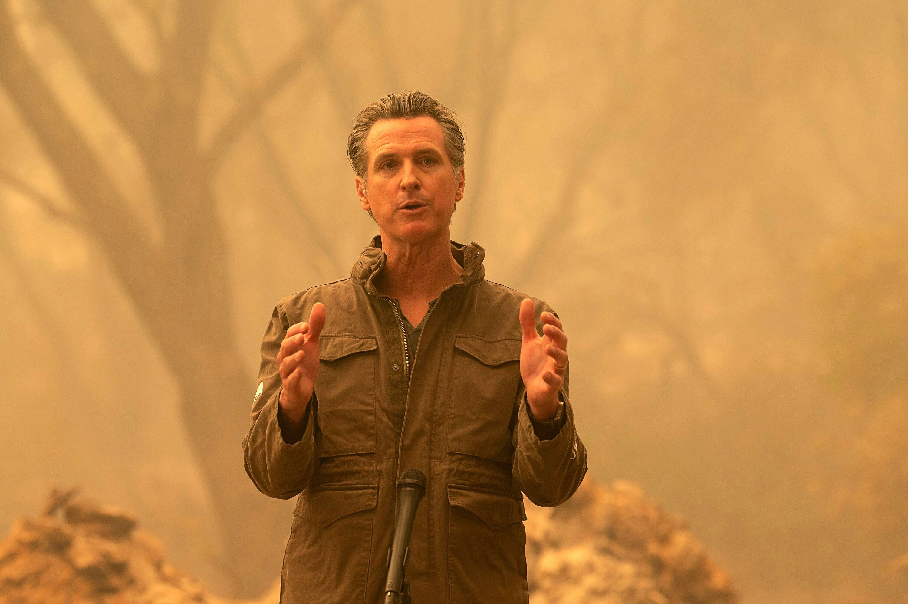 California Gov. Gavin Newsom speaks to the media after he toured the North Complex Fire zone in Butte County on Friday, Sept.