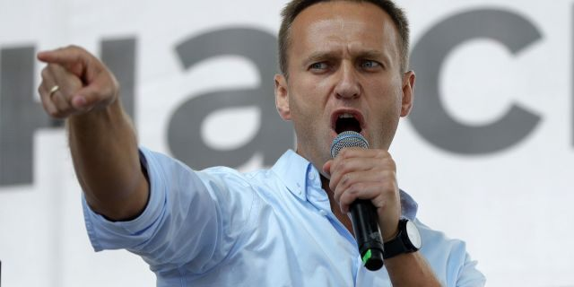 Russian opposition activist Alexei Navalny gestures while speaking to a crowd during a political protest in Moscow, Russia on July 20, 2019. (AP Photo/Pavel Golovkin, File)