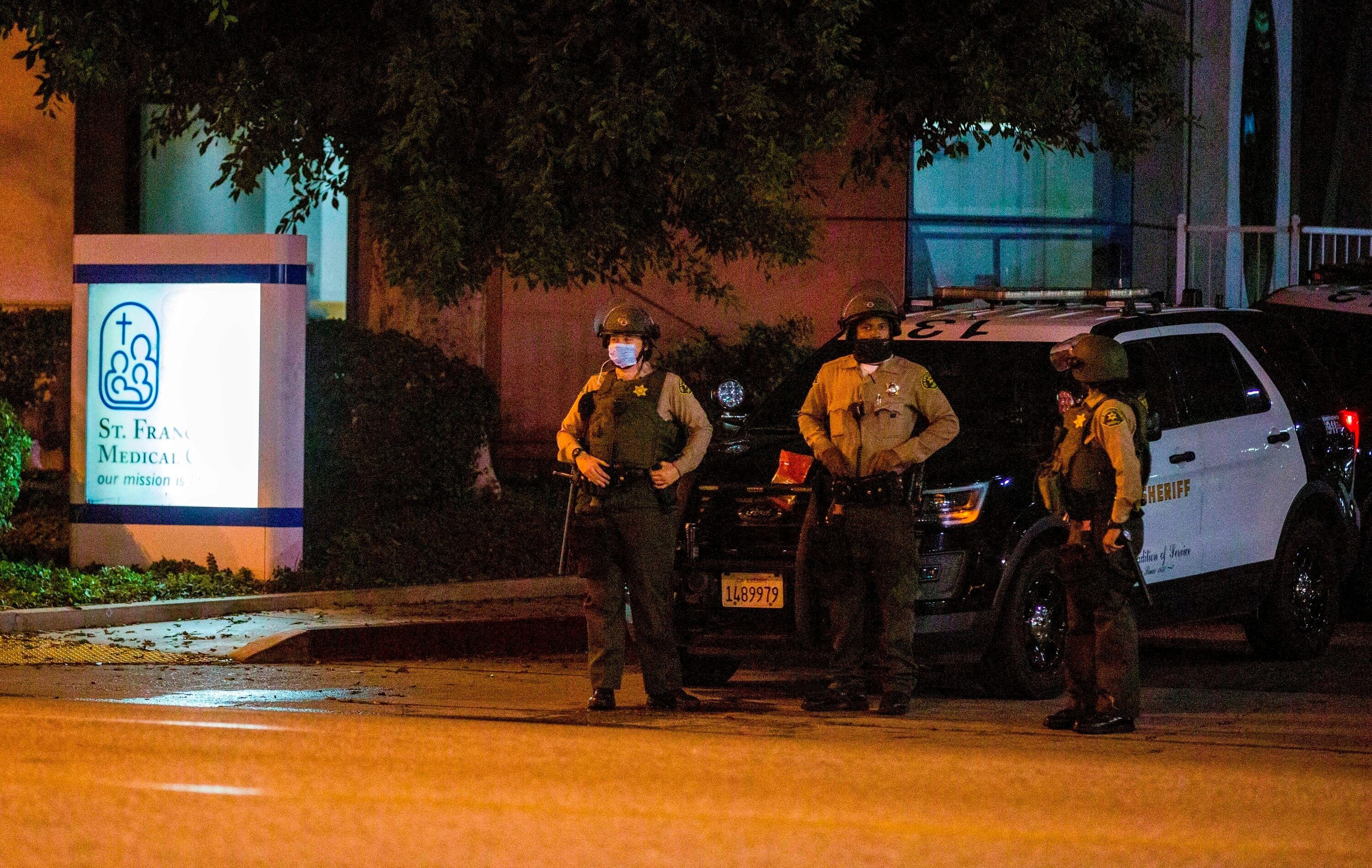 Los Angeles County Sheriff's deputies guard the entrance to St. Francis Medical Center early Monday, Sept. 13, 2020, after tw