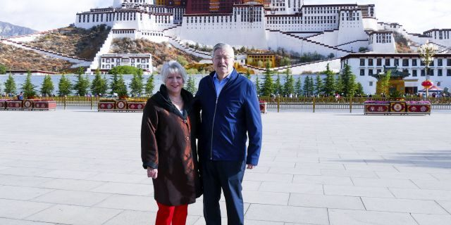In this May 22, 2019 photo released by the U.S. Embassy in Beijing, U.S. Ambassador to China Terry Branstad and his wife Christine pose for a photo in front of the Potala Palace in Lhasa in western China's Tibet Autonomous Region. (U.S. Mission to China via AP, File)