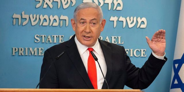 Israeli Prime Minister Benjamin Netanyahu speaks during a briefing on coronavirus development in Israel at his office in Jerusalem, Sunday, Sept. 13 2020. Netanyahu announced a new countrywide lockdown will be imposed amid a stubborn surge in coronavirus cases, with schools and parts of the economy expected to shut down in a bid to bring down infection rates. (Alex Kolomiensky/Yedioth Ahronoth via AP, Pool)