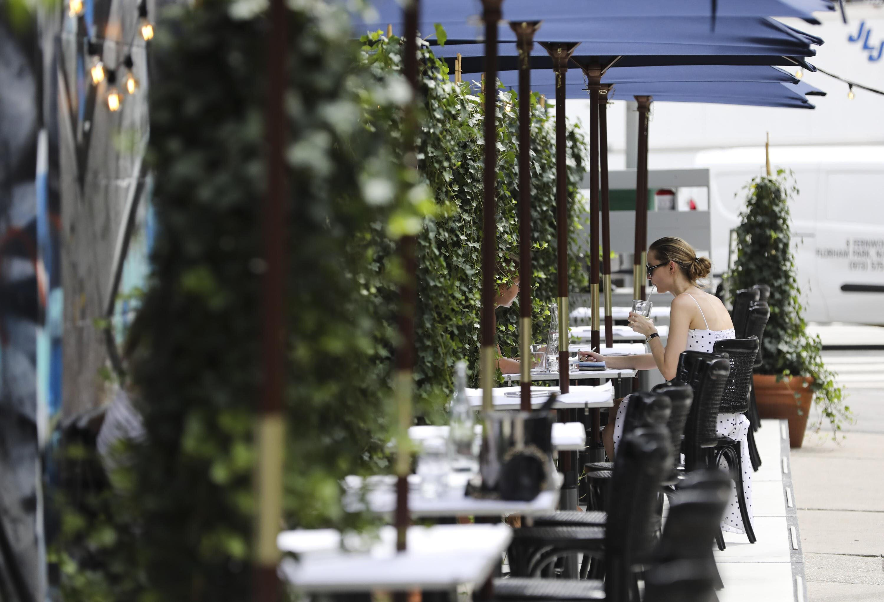 An outdoor dining area in New York City on July 30.Adults who tested positive for the coronavirus were roughly twice as
