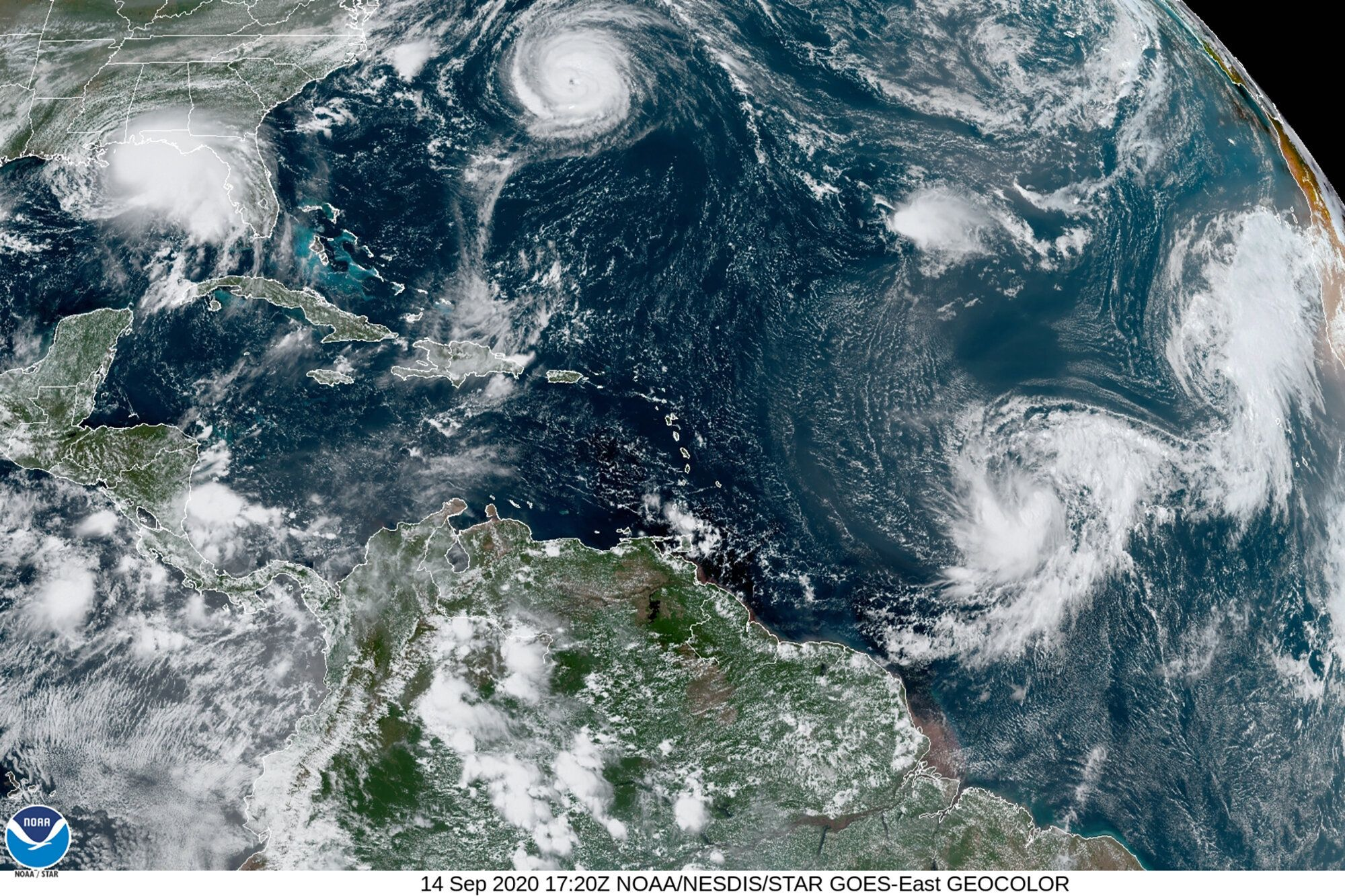 This satellite image shows five tropical cyclones churning in the Atlantic basin on Monday. The storms, from left, are Hurric