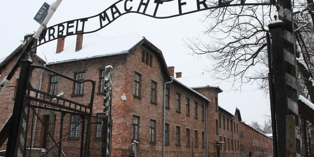 'Arbeit Macht Frei' sign at the former Nazi concentration camp Auschwitz in Oswiecim, Poland on 27 January 2015. (Photo by Jakub Porzycki/NurPhoto via Getty Images)