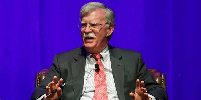 In this Wednesday, Feb. 19, 2020, file photo, former national security adviser John Bolton takes part in a discussion on global leadership at Vanderbilt University, in Nashville, Tenn. Bolton released a scathing memoir about his time in the Trump administration earlier this year. (AP Photo/Mark Humphrey, File)