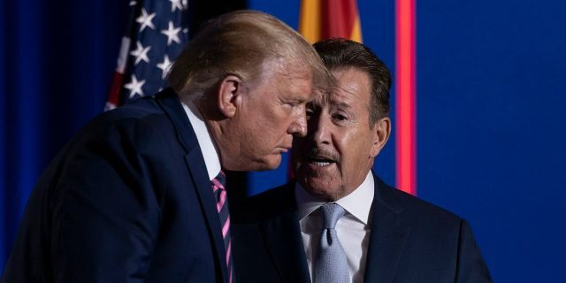 President Donald Trump speaks with Arte Moreno, owner of the Los Angeles Angels MLB baseball team, right, at the conclusion of a Latinos for Trump Coalition roundtable at Arizona Grand Resort & Spa, Monday, Sept. 14, 2020, in Phoenix. (AP Photo/Andrew Harnik)
