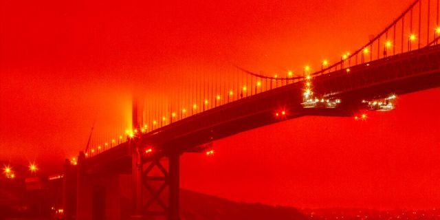 The Golden Gate Bridge at 11 a.m. Wednesday, Sept. 9, 2020, in San Francisco, amid a smoky, orange haze caused by the ongoing wildfires. (Frederic Larson via AP)