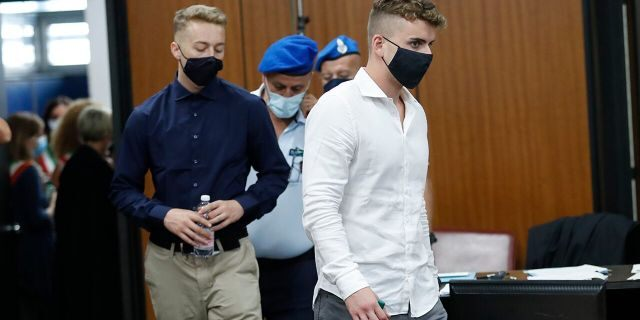 Gabriel Natale-Hjorth, right, and Finnegan Lee Elder, from California, arrive in court for a hearing in their trial where they are accused of slaying a plainclothes Carabinieri officer while on vacation in Italy last summer, in Rome, Wednesday, Sept. 16, 2020. (Remo Casilli/Pool Photo via AP)