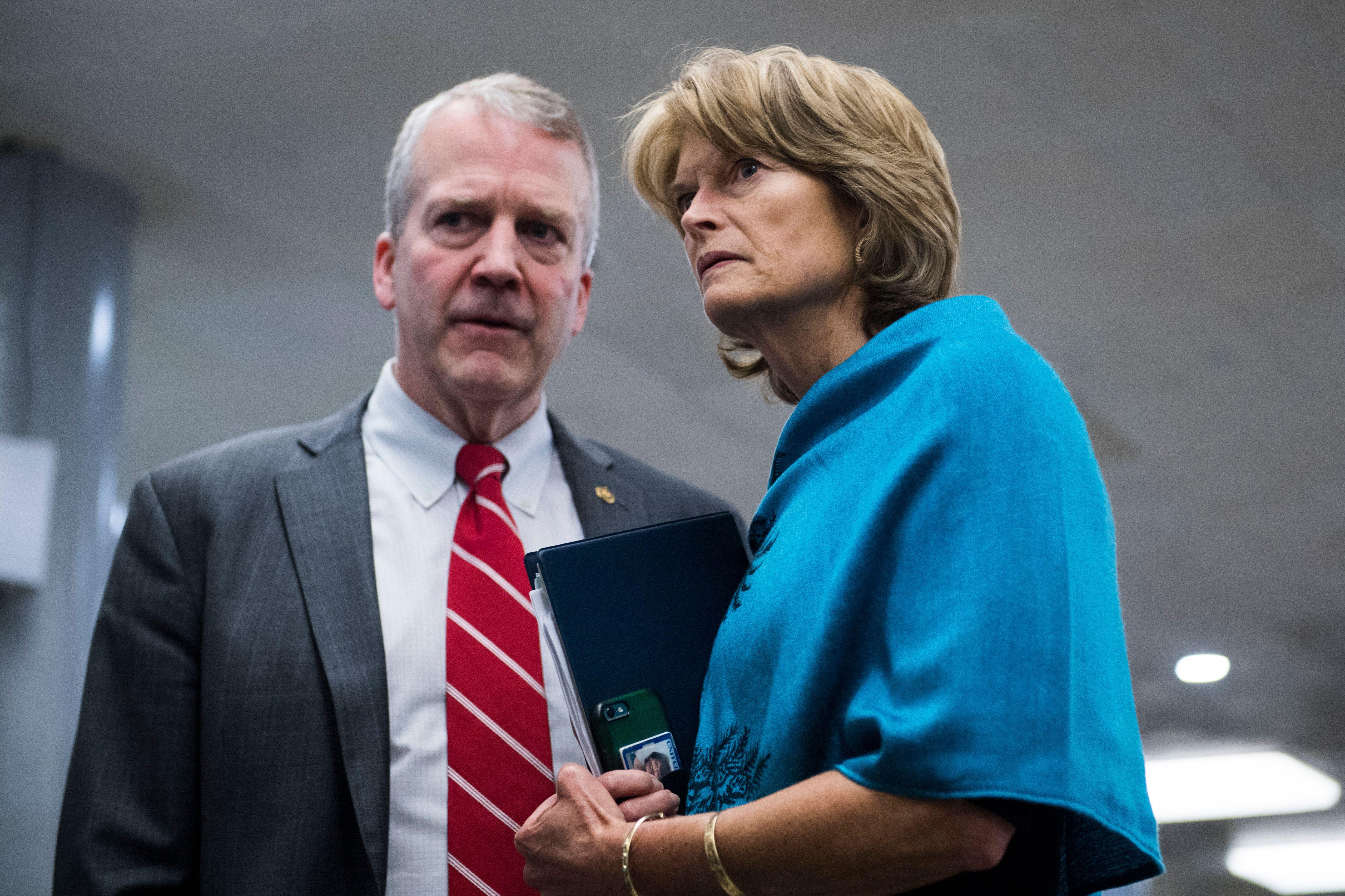 Sens. Dan Sullivan and Lisa Murkowski, Alaska Republicans, consult on Capitol Hill. Murkowski has a more moderate record, inc