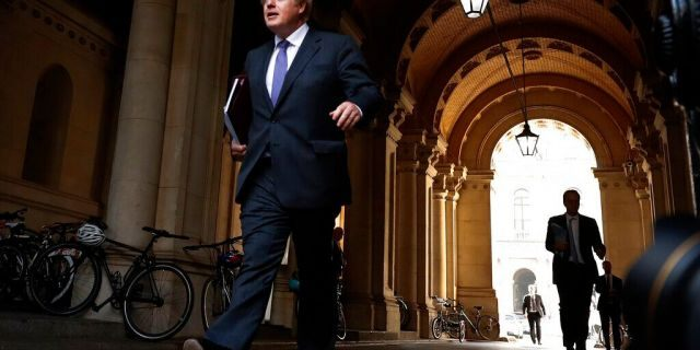 Britain's Prime Minister Boris Johnson walks to his office in Downing Street after a cabinet meeting in London, Tuesday, Sept. 15, 2020.(AP Photo/Frank Augstein)