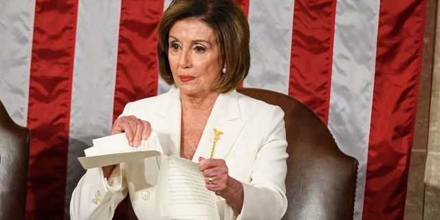 Speaker of the House of Representatives Nancy Pelosi rips a copy of President Donald Trump's speech after he delivered the State of the Union address at the US Capitol in Washington, D.C., on Feb. 4, 2020. (Photo by MANDEL NGAN/AFP via Getty Images)