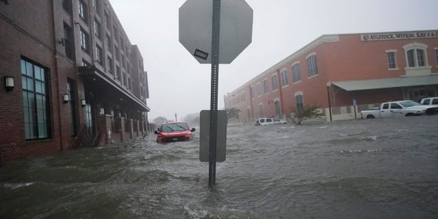 Floodwaters move on the street, Wednesday, Sept. 16, 2020, in Pensacola, Fla. Hurricane Sally made landfall Wednesday near Gulf Shores, Alabama, as a Category 2 storm, pushing a surge of ocean water onto the coast and dumping torrential rain.