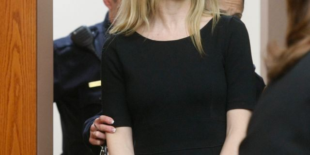 """Amy Locane enters the courtroom to be sentenced in Somerville, N.J. The former """"Melrose Place"""" actress who has already served a prison sentence for a fatal 2010 drunk driving crash in New Jersey is headed back behind bars."""