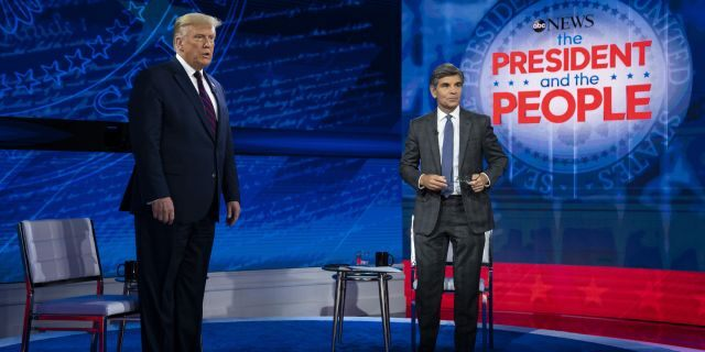 President Trump talks with ABC News anchor George Stephanopoulos before a town hall at National Constitution Center, Sept. 15, 2020, in Philadelphia. (Associated Press)