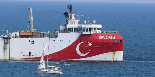 Turkey's research vessel, Oruc Reis anchored off the coast of Antalya on the Mediterranean, Turkey, Sunday, Sept. 13, 2020. Greece's Prime Minister Kyriakos Mitsotakis welcomed the return of a Turkish survey vessel to port Sunday from a disputed area of the eastern Mediterranean that has been at the heart of a summer stand-off between Greece and Turkey over energy rights. (AP Photo/Burhan Ozbilici)