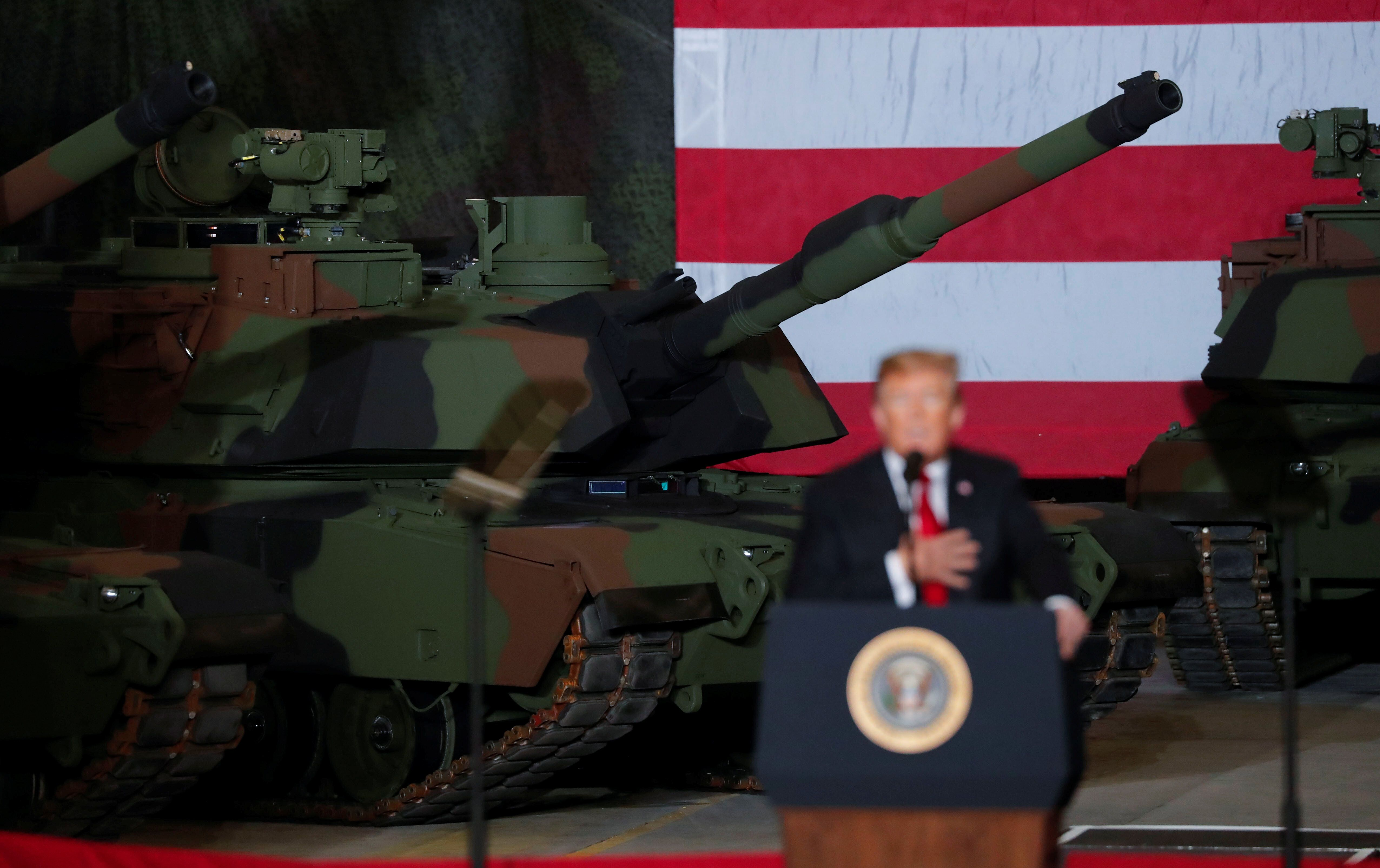 President Donald Trump speaks to workers in front of tanks on display at the Lima Army Tank Plant Joint Systems Manufacturing