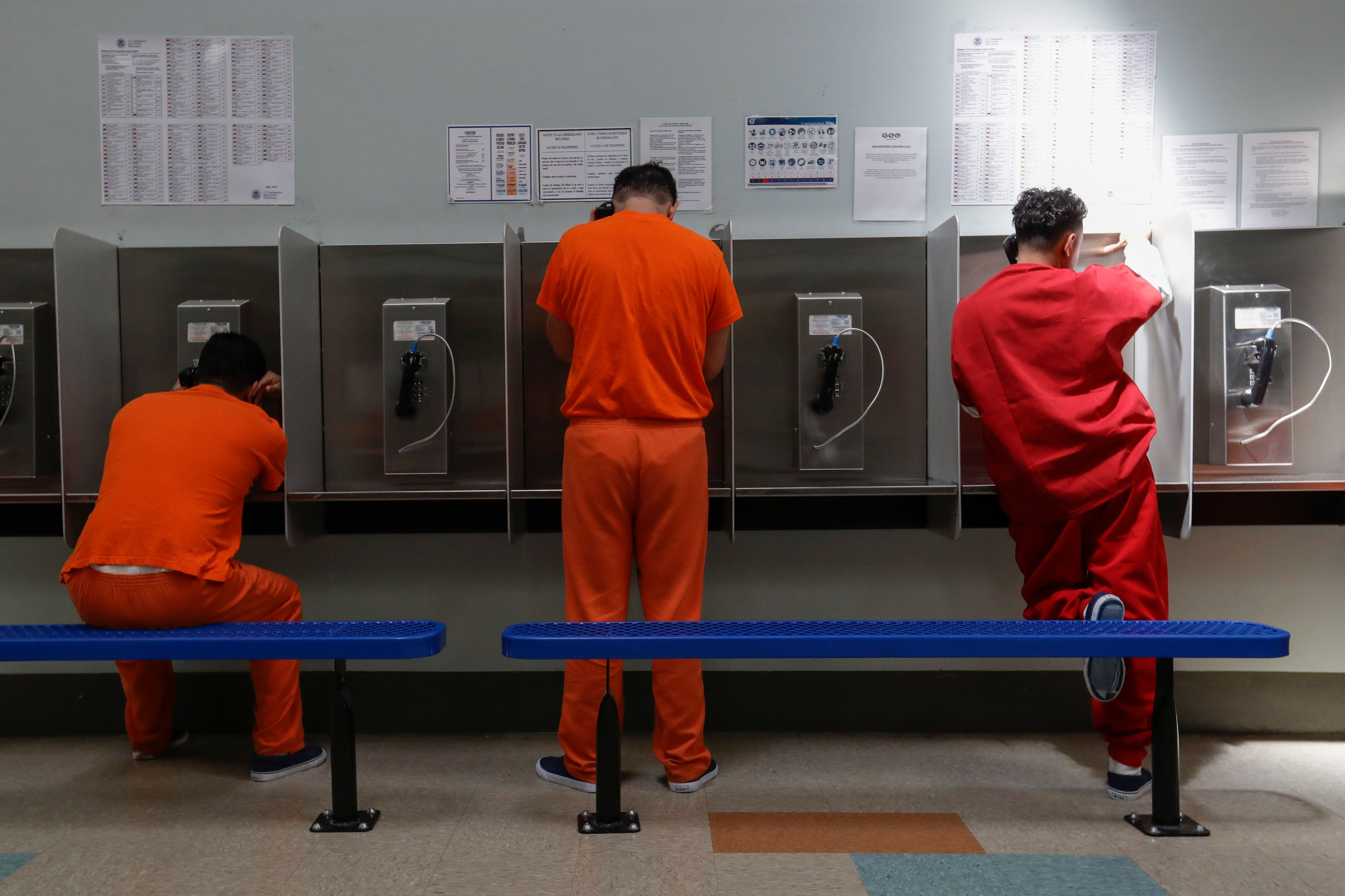 Detainees talk on the phones at the Adelanto ICE Processing Center in Adelanto, Calif. on Aug. 28, 2019.