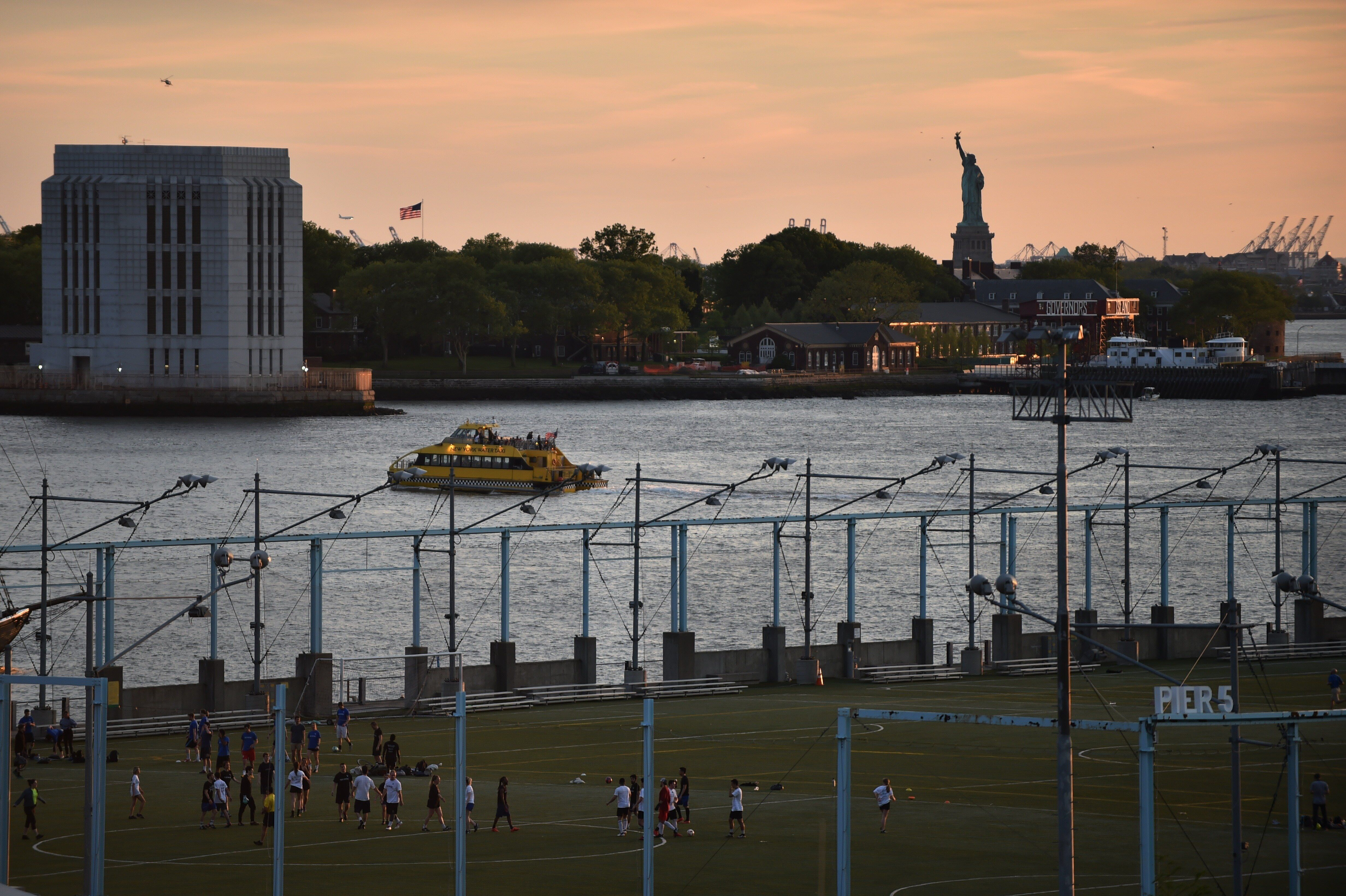 A planned statue of Ginsburg may get a view of the Statue of Liberty like this soccer field in Brooklyn Bridge Park enjoys.