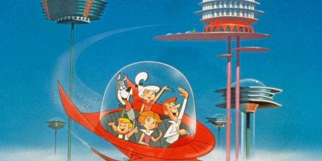 """The Jetson family wave as they fly past buildings in space in their spaceship in a still from the animated television series, """"The Jetsons,"""" circa 1962. (Warner Bros./Courtesy of Getty Images)"""