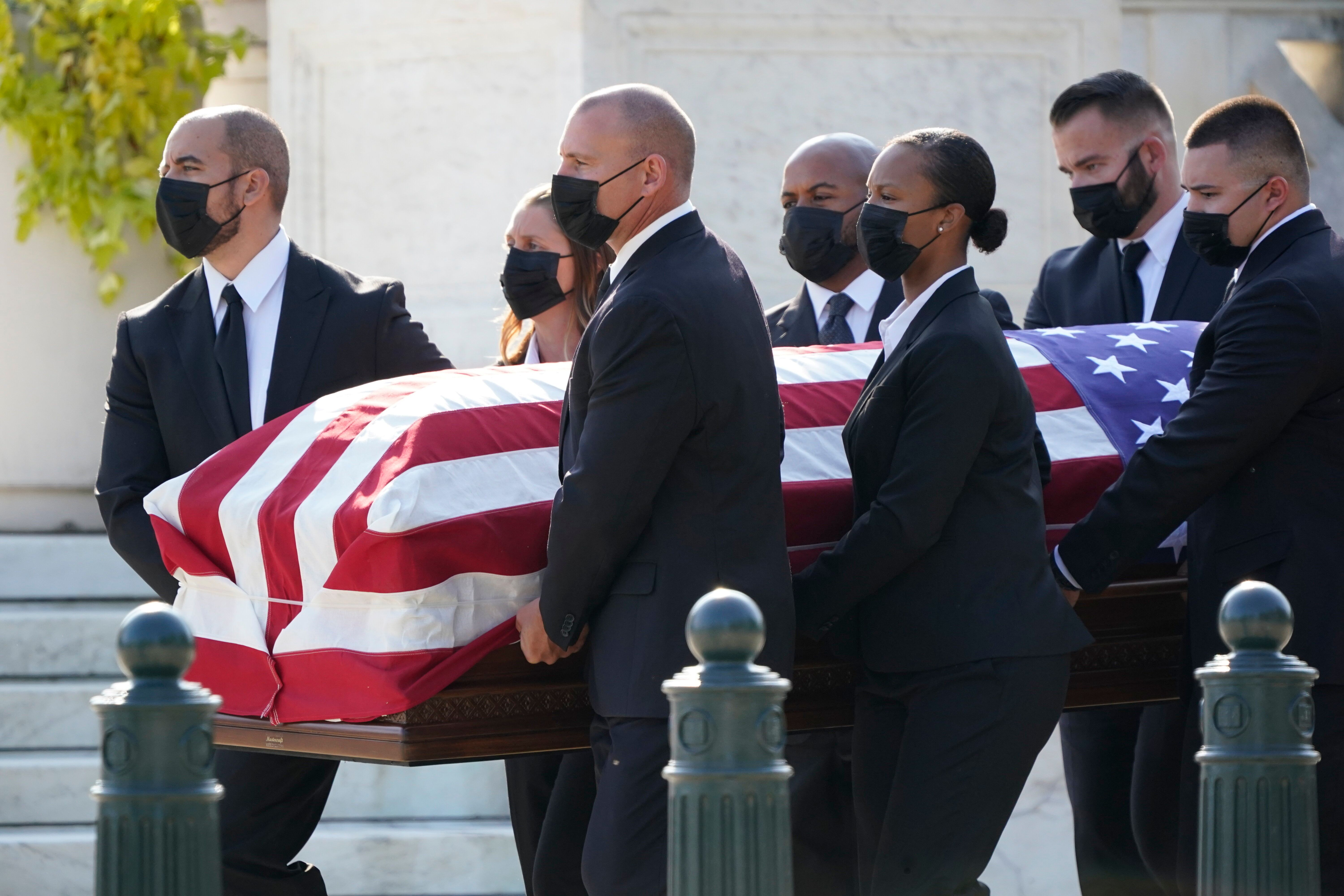 The flag-draped casket of Justice Ruth Bader Ginsburg arrives at the Supreme Court in Washington, Wednesday, Sept. 23, 2020.
