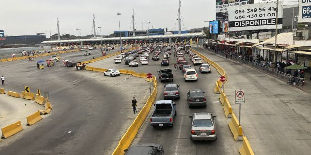 Cars wait in line to enter the United States at San Diego's San Ysidro border crossing on Tuesday in Tijuana, Mexico. (AP)