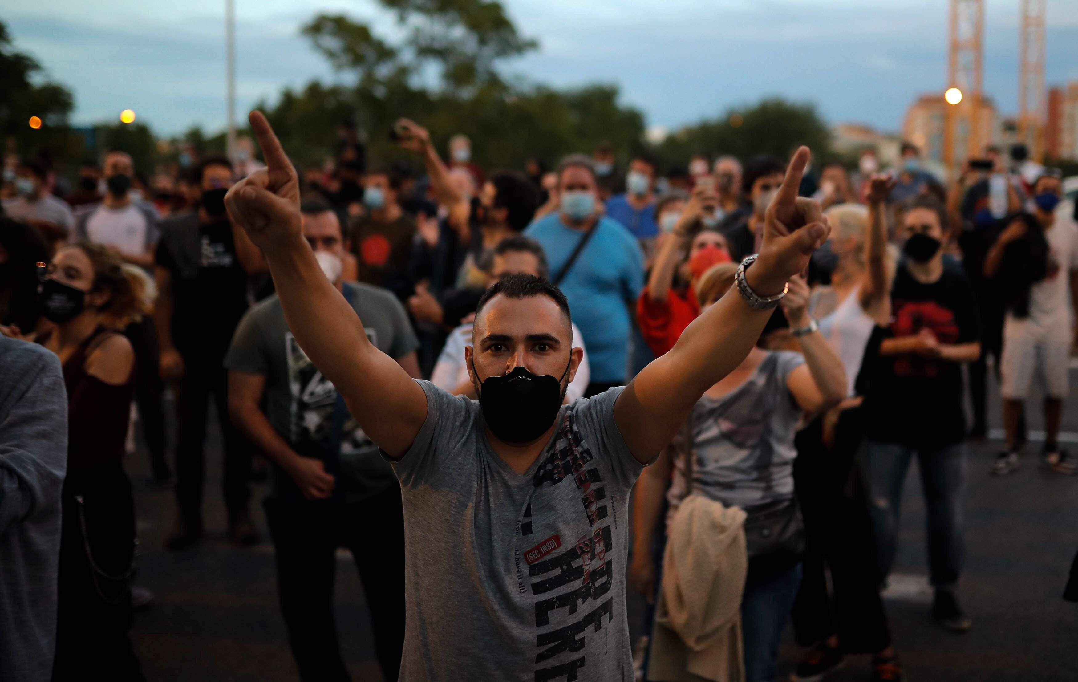 Protesters take part in a demonstration in the Vallecas neighborhood of Madrid against measures imposed by the Madrid regiona