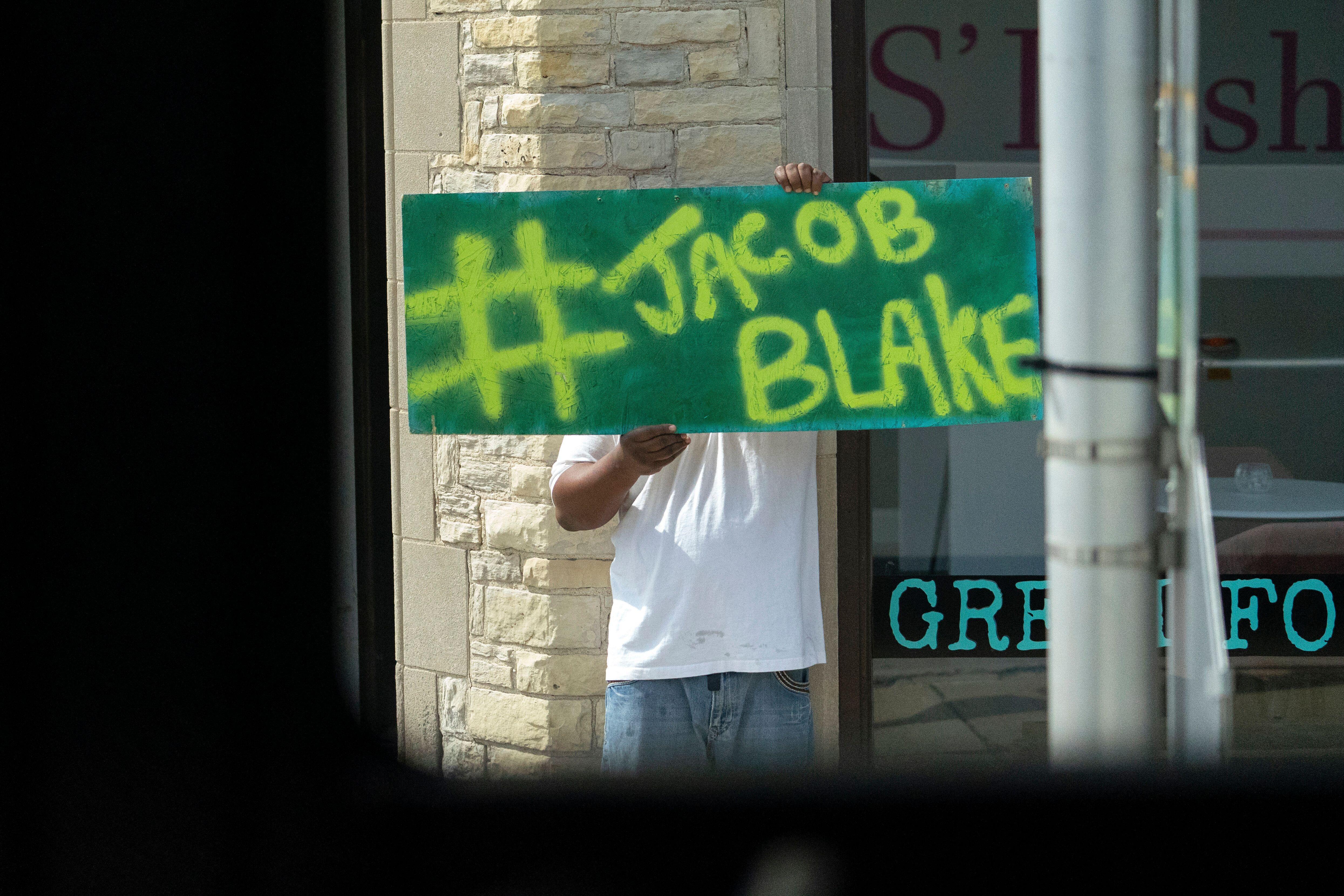 As Democratic nominee Joe Biden's motorcade made its way through Kenosha, Wisconsin, earlier this month, an onlooker held up