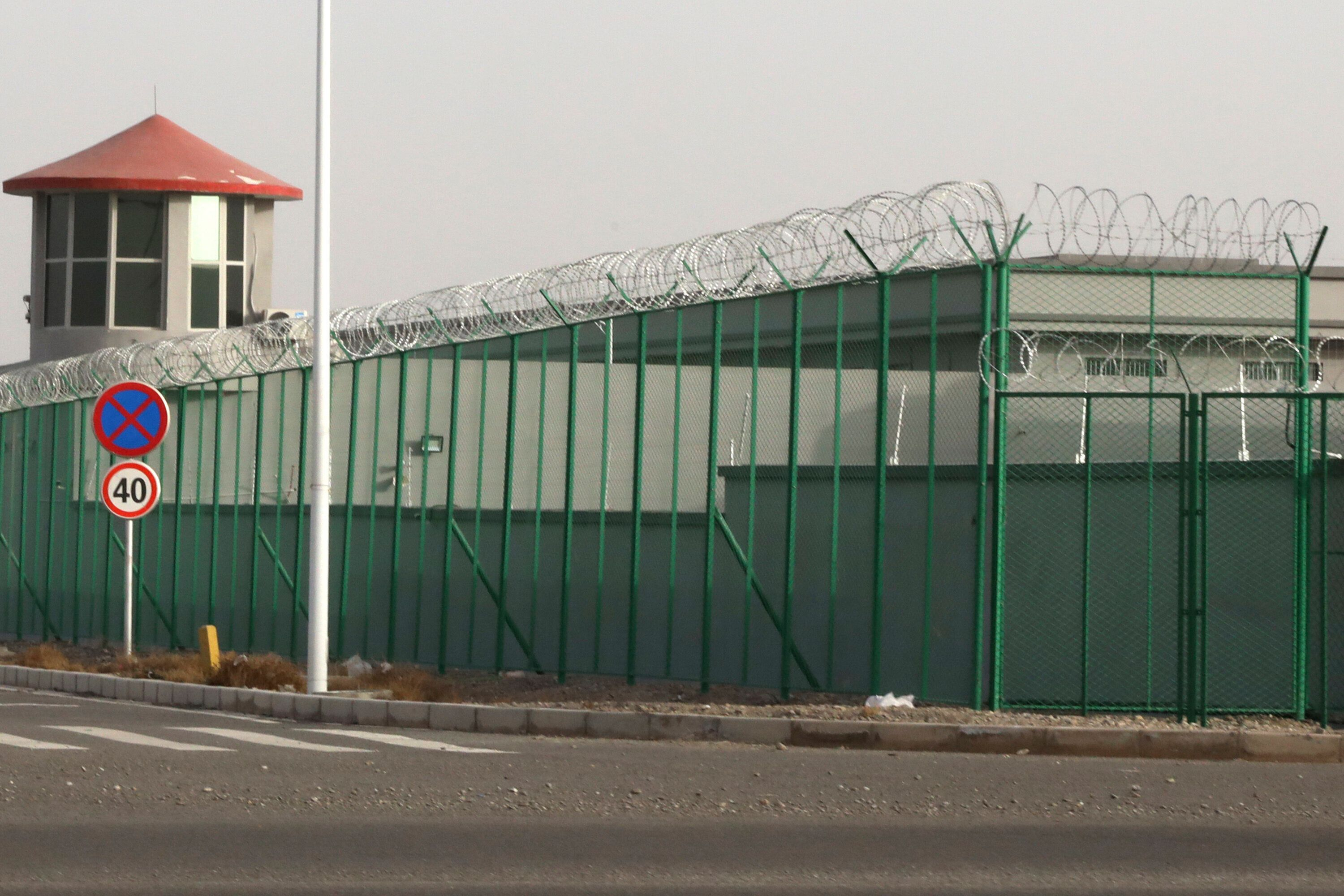 In this Dec. 3, 2018, file photo, a guard tower and barbed wire fences surround an internment facility in the Kunshan Industr