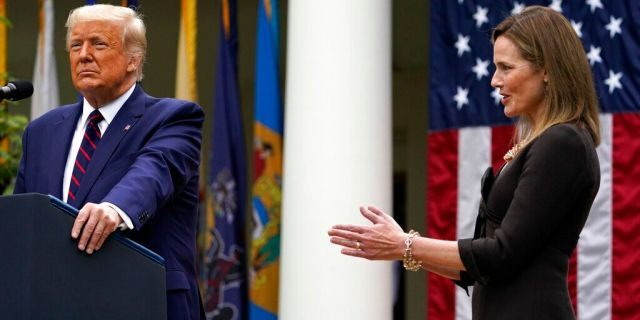 Judge Amy Coney Barrett applauds as President Donald Trump announces Barrett as his nominee to the Supreme Court, in the Rose Garden at the White House, Sept. 26, in Washington. (AP Photo/Alex Brandon)
