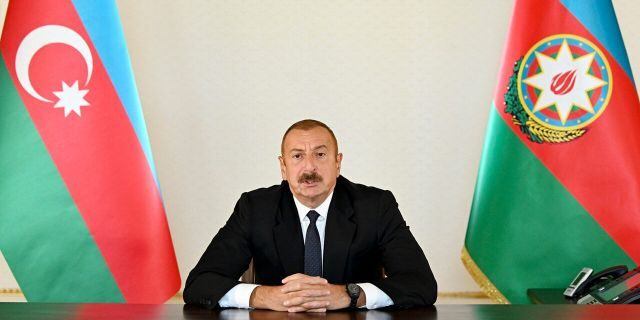 In this photo provided by Azerbaijan's Presidential Press Office provided on Sunday, Sept. 27, 2020, Azerbaijani President Ilham Aliyev addresses the nation in Baku, Azerbaijan.