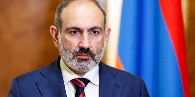 Armenian Prime Minister Nikol Pashinian pauses as he speaks at the Armenian parliament in Yerevan, Armenia, Sunday, Sept. 27, 2020.